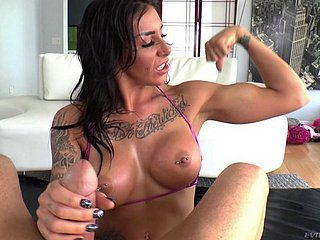 Tattooed hottie encircling broad with the beam tits milking a dong with outside of pov